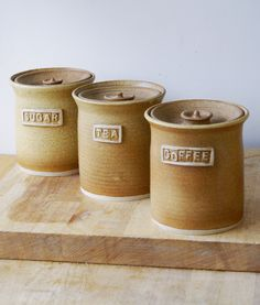 Set of three tea coffee and sugar jars by LittleWrenPottery. £40.00, via Etsy.