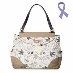 """Feminine and delicate, the Hope (dove) for Prima Bags adds a sweet, inspiring touch to casual outfits. Dove silhouettes in black and tan fly through leafy branches against a white cotton sky. She also features taupe pebble-grained faux leather in all the right places. The word """"Hope"""" scattered subtly among the birds is the perfect finishing touch for this enchanting Shell. Side pockets."""