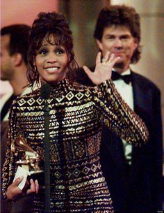Whitney Houston waves to the crowd at the 36th Ann