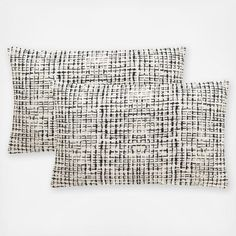 When traditional patterns don't compute, look to the contemporary motif of these accent pillows. Their hidden zipper and feather fill make them ultra- user-friendly in modern designer interiors.