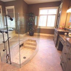 Sunken shower!!! Coolest thing ever!! I seriously love this idea, its like a pool! plus it still has a shower!
