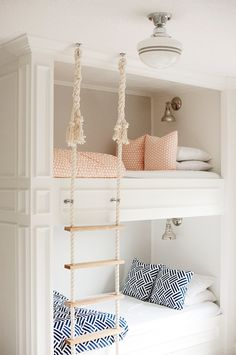 Built in bunk beds with rope ladder, wall sconce bunk lighting, orange and blue bedding | Mikael Reeve Monson Photography