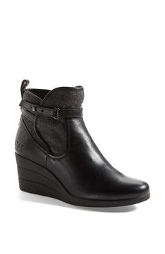 Free shipping and returns on UGG® Australia 'Emalie' Waterproof Leather Bootie (Women) at Nordstrom.com. A moto-inspired wedge bootie cast in sleek waterproof leather features a chic textile shaft inset for a look that's right on trend. The plush footbed is crafted from UGGpure™, a moisture-wicking textile made entirely from wool but crafted to feel and wear like genuine shearling—keeping feet cozy and comfortable no matter the weather.