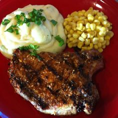 Grilled Malibu pork chops, creamy seasoned mashed potatoes with cheddar & chives, sweet white corn