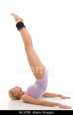 portrait of a young caucasian woman does gymnastics with ankle weights Stock Photo