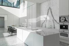 Kitchen with statuario marble by Mass Architect, marble by Il Granito. Photo: Tineke de Vos.