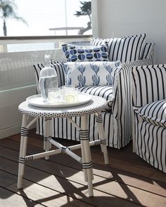 Outdoor Riviera Side Table - Sundial Chair - Riviera - Outdoor Living Inspiration - Classic via Serena & Lily Outdoor Side Table, Chair Side Table, Outdoor Chairs, Striped Chair, Outdoor Pillow Covers, Coastal Living Rooms, Bench With Storage, Chair And Ottoman, Swivel Chair