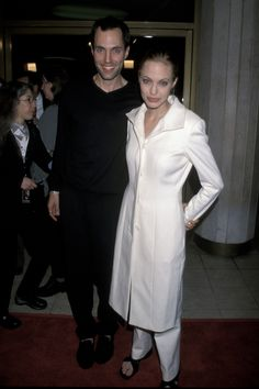 Early signs of her signature minimalist style? With her brother, James Voight, at a screening of The Bone Collector in November 1999.   - ELLE.com