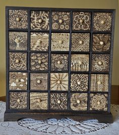 pyrographic cabinet with drawers each 5cm square; trees and celtic patterns.