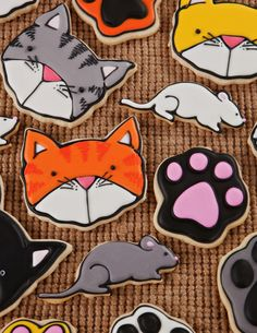 Kitten face, cat, mouse and paw print decorated sugar cookies using royal icing