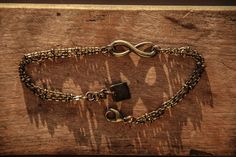 "Infinity Bracelet $10 8"" long bracelet mad with antiqued brass chain, charm and findings."