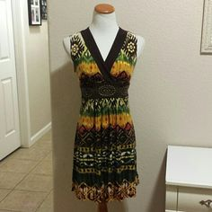 "Brown tribal print dress Brown, orange, green tribal print dress. Empire waist with studded embellishment. Stretchy. Measures 32"" from shoulder to hem. Laying flat 17"" across chest. Would best fit a ladies 6 or 8 BCX Dresses"