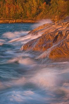 Autumn Pictured Rocks National Lakeshore - Autumn landscape of waves and the eroded sandstone shoreline of Lake Superior at Pictured Rocks National Lakeshore, Michigan's Upper Peninsula, USA
