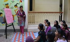 Teenage girls from Kolkata, India, attend an interactive health workshop led by CI's Youth Health Corps members.