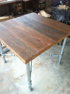 """36"""" SQUARE PIPE LEG TABLE WITH SALVAGED ANTIQUE HEART PINE BEAM TOP.  $600"""