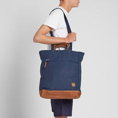 A larger version of the popular Totepack No.1, this convenient everyday bag from Fjällräven is extra durable with its natural toned leather base. The versatile Tote Bag No.2 is constructed from their signature G-1000 fabric, the 16L main compartment is equipped with a zip closure, finished with shoulder straps allowing it to be converted to a backpack.  G-1000® Fabric Construction Volume 16L Carry Handle Shoulder Straps Zip Closure Main Compartment Leather Detailing Fjällräven Logo Patch