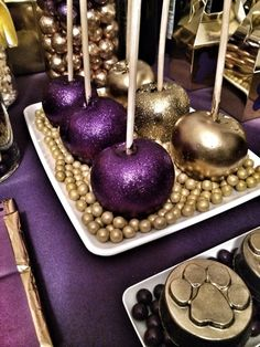 Mardi Gras colored purple and gold candy apples. These could make fun wedding favors!