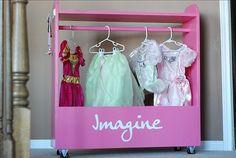 """dream, imagine, believe"" on side of dress up closet"