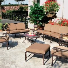 Darlee Nassau 7-person Cast Aluminum Deep Seating Patio Conversation Set - Antique Bronze by Darlee. $1877.85. Set Includes: Coffee Table, 2 End Tables, Sofa, Loveseat, 2 Lounge Chairs, Ottoman, Brown Polyester Cushions. Relax more comfortably with polyester seat cushions. Antique bronze powder coating is tougher than conventional paint finishes. Lightweight aluminum frame makes rearranging your furniture easy. Cast aluminum construction promotes rust resistance. Darlee ...