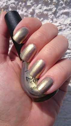 Nicole by OPI - sea how far you go  Pretty cool color, goes from gray to gold, looks very interesting