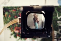 awesome way to get a old styled photo using both your digital and a vintage camera, love it!