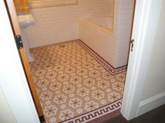 Mosaic tile in the hexagon shape (hex tile) can make intricate patterns. Check out the Greek Key border around it.