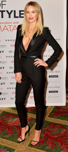 Tailor-made: Alex Gerrard shows off her ample assets in a plunging tuxedo style black jump...