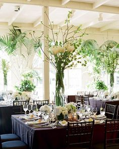 Maybe a few tall centerpieces with palm fronds.  I think would fit the feel of the inn.