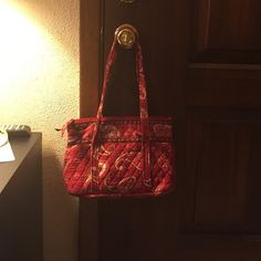 Vera Bradley purse Vera Bradley purse.  Very good clean condition.  Retired pattern called Mesa Red from July 2006 to July 2008.  Very pretty purse. Zipper on top.  6 pockets on inside.  One nice pocket on outside. Vera Bradley Bags Satchels