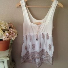 FREE PEOPLE BoHo. Baby doll. Free spirit top. Worn once, pristine condition. Light and airy. This free spirit BoHo top is so cute with your favorite cutoff's and ankle boots! Reasonable offers are welcome. If you love FP check out my closet!! Free People Tops Crop Tops