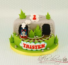 Love the bottom and the train coming out with the puffs of smoke. Thomas the Tank Engine Cake