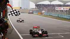 McLaren's Lewis Hamilton chases down championship leader Sebastian Vettel's Red Bull to win a thrilling Chinese Grand Prix. Lewis Hamilton Wins, Chinese Grand Prix, Ubs, Formula One, Red Bull, Victorious