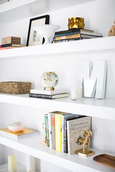 Styled white shelves with books and collected objects