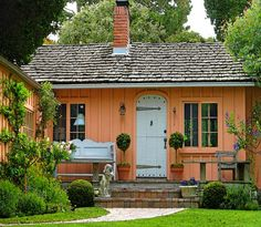 Orange cottage with blue door.