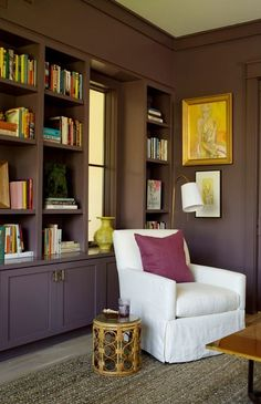 Suzie: Angie Hranowski - Chic den with purple built-ins, ime green vase, white slipcover chair, ...