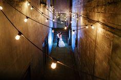 Kissing under the lights at the West End Ballroom, Portland, Oregon  https://www.joshuameador.com/weddings/west-end-ballroom