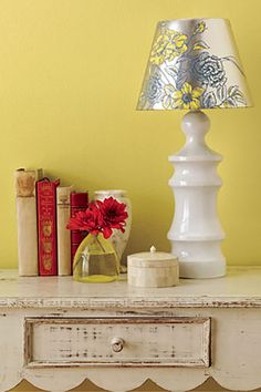 Use a pretty wallpaper pattern, like the metallic floral print one, to transform a simple lampshade into a beautiful one.  Instructions: Wallpaper Lampshade