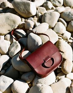 Joining her collection ofleather stitched and sculptural brass jewelry,Andria Crescionihas introduced two gorgeous, newhandbag styles. A structural saddle bag and clutch, available in oxblood and black, featureCrescioni's signature leather handles and are constructed using the same saddle