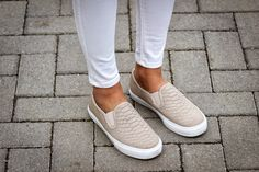 White jeans with snakeskin sneaker flats.