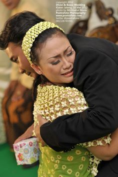 Sungkeman: Javanese tradional wedding procession, both bride and groom begged the blessing of their parents. photo by Poetrafoto Wedding Photographer Indonesia based in Yogyakarta Jakarta Bali, other photo's please log on http://poetrafoto.com