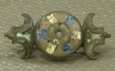 Fibula with enamel, Roman period, Chelles. www.kornbluthphoto.com/images/ChellesRomEnamelFibNA.jpg