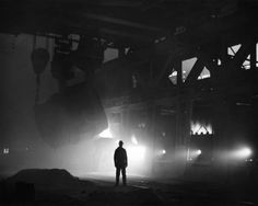 One hundred tons of molten iron poured into an open hearth furnace, Gary Works, Carnegie-Illinois Steel Corp. (circa 1937)