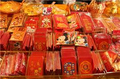 Red Envelope  Red envelopes are gifts presented at social and family gatherings such as weddings or on holidays such as the Chinese New Year. The red color of the envelope symbolizes good luck and is supposed to ward off evil spirits. The amount of money contained in the envelope usually ends with an even digit, in accordance with Chinese beliefs; odd-numbered money gifts are traditionally associated with funerals. There is also a widespread tradition that money should not be given in fours…