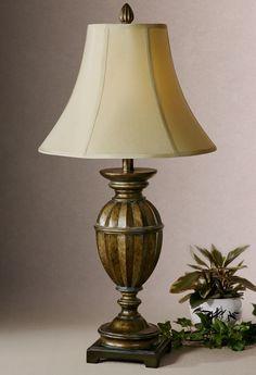 Очаровательная настольная лампа от производителя Uttermost. •Выполнена в темной отделке с золотыми оттенками. •Рассчитана на 100W.             Материал: Металл, Ткань.              Бренд: Uttermost.              Стили: Классика и неоклассика.              Цвета: Бежевый, Темно-коричневый.