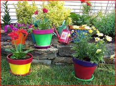I painted terracotta pots last spring and it really made for a cheerful and colorful garden. Colorful Garden, Colorful Flowers, Container Flowers, Terracotta Pots, Planter Pots, Plants, Diy, Outdoor, Gardening