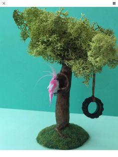 Miniature parrot sitting on a tree by Littlemissminiature on Etsy