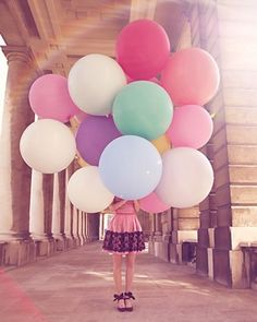 It would be really cute with two people as well - maybe kissing behind the balloons?