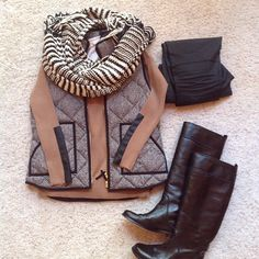 Winter outfit. Brown Vest. Light Brown Long Sleeve. Black Riding Boots. Black and White Striped Scarf. Black Leggings.