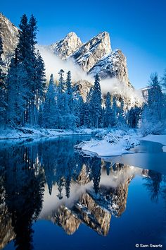 ✯ Three Brothers - Merced River, Yosemite. Established in 1890, Yosemite National Park embraces a spectacular tract of mountain-and-valley scenery in the Sierra Nevada. Yosemite Park's awe-inspiring landscape includes waterfalls, meadows, and forests with groves of giant sequoia trees. Today, Yosemite National Park spans nearly 1,200 square miles.