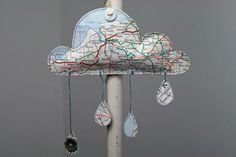 Paper cloud with raindrops artwork - in a map location of your choice. $12.95, via Etsy.